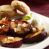 Roasted brown sugar plums with Ameretto whipped cream